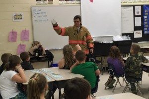 Cpt. Cindy Murphy goes over fire safety tips with the West Milford first graders